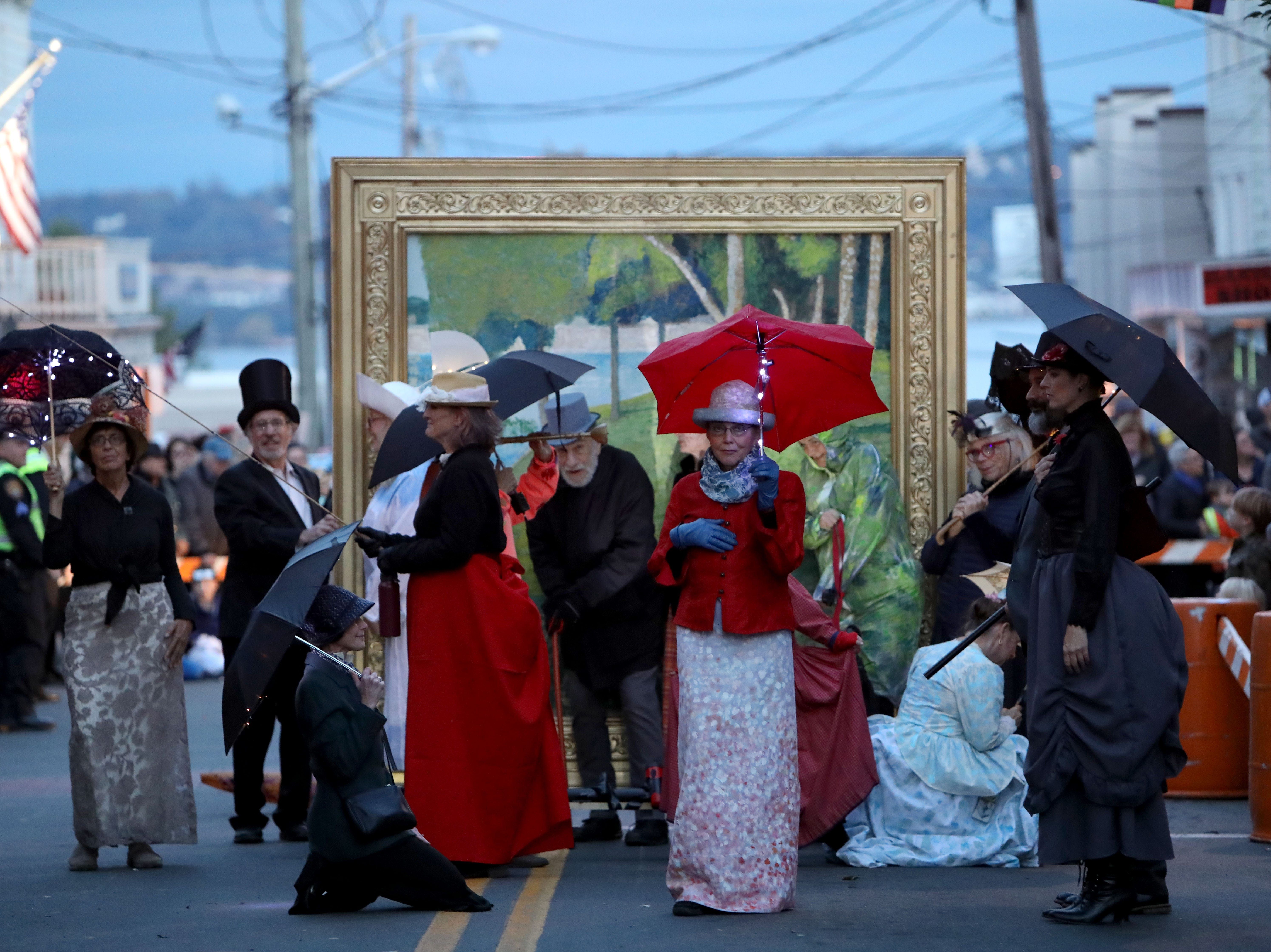"""The Nyack Art Collective and their """"Escape Artists"""" float inspired by a George Seurat painting march in the 31st annual Nyack Halloween parade hosted by the Chamber of Commerce Oct. 28, 2018."""