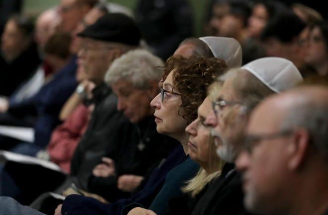 Over one-thousand area residents filled the seats and stood during a vigil at Congregation Kol Ami in White Plains Oct. 28, 2018 in response to Saturday's fatal shooting at a Pittsburgh synagogue. The vigil was organized by several Westchester County based Jewish organizations .