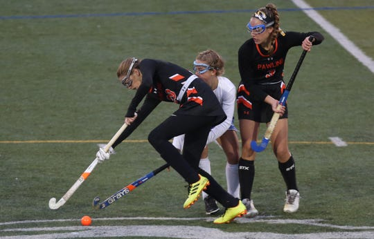 From left, Pawling's Kendall Arnold (20) and Kiera Tucci (3) keep the ball away from North Salem's Stella DiDomenico (5) during the Section 1 Class C championship at Brewster High School Oct. 27, 2018. Pawling won the game 2-1.