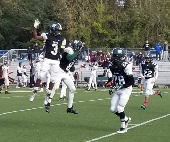 Woodlands' Jaden Shelton (3) and Donovan Williams (8) celebrate after a touchdown score during the team's Section 1 Class C semifinal game against Valhalla at Woodlands High School on Sunday, October 28th, 2018. Woodlands won 38-22.