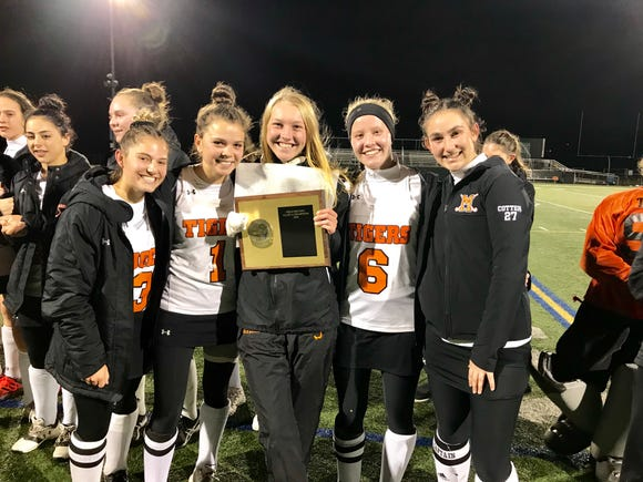 Mamaroneck field hockey players pose with the championship plaque after defeating Horace Greeley 2-0 in the Section 1 Class A title game at Brewster High School on Saturday, October 27th, 2018.