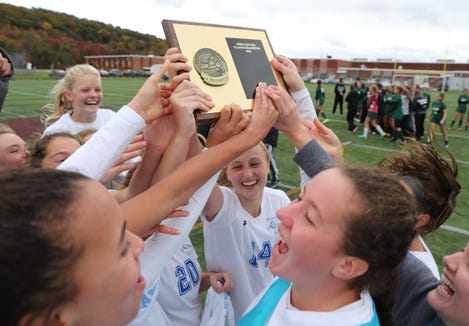 Bronxville holds the section 1 plaque after defeating Pleasantville 3-1 to claim the girls Class B soccer sectional title at Arlington High School in Freedom Plains on Sunday, October 28, 2018.