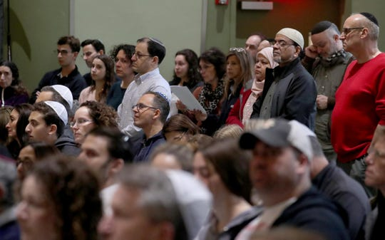 Hundreds of area residents filled the seats and stood during a vigil at Congregation Kol Ami in White Plains Oct. 28, 2016 in response to Saturday's fatal shooting at a Pittsburgh synagogue. The vigil was organized by several Westchester County based Jewish organizations .