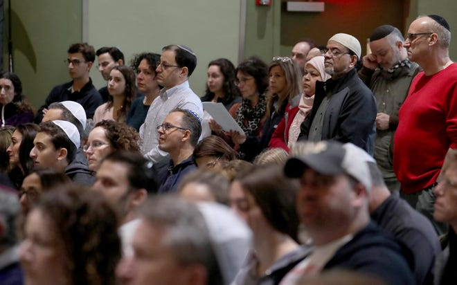 Hundreds of residents in White Plains, New York, filled gathered for a vigil at Congregation Kol Ami in White Plains on Sunday, Oct. 28, 2018, in response to Saturday's fatal shooting at a Pittsburgh synagogue.