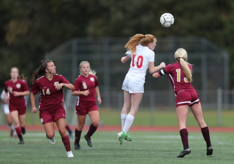 Kelly Brady (10) goes for a header during last year's Section 1 Class AA title game against Arlington at Arlington High School.