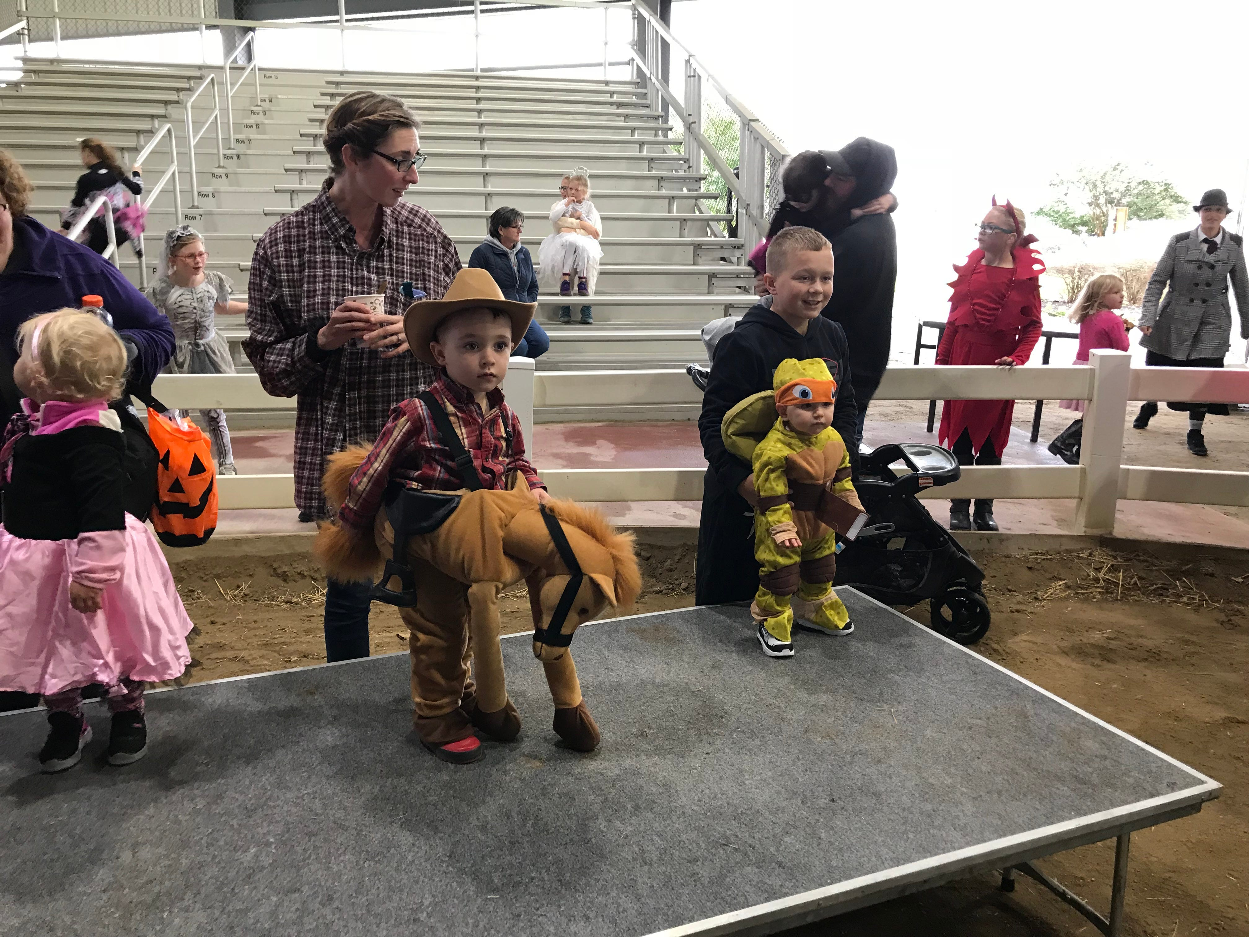 Kids start to line up for the youngest category of the costume contest at the  Great Delaware Pumpkin Carve Saturday.