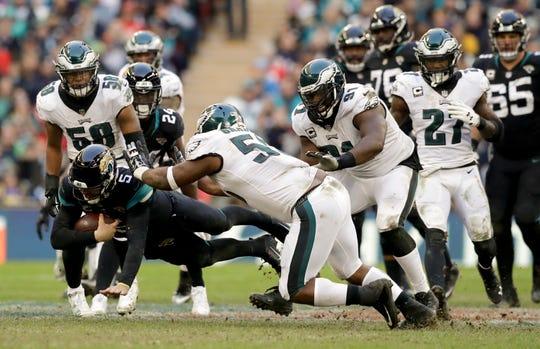 Jacksonville Jaguars quarterback Blake Bortles (5) dives to make a down during the second half of an NFL football game against Philadelphia Eagles at Wembley stadium in London, Sunday, Oct. 28, 2018. (AP Photo/Matt Dunham)