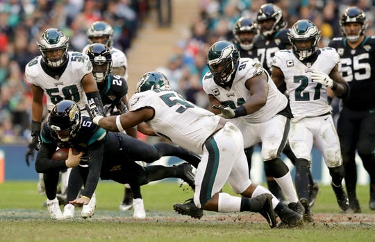 Jacksonville Jaguars quarterback Blake Bortles (5) dives to make a down during the second half of an NFL football game against Philadelphia Eagles at Wembley stadium in London, Sunday, Oct. 28, 2018. (AP Photo/Matt Dunham)