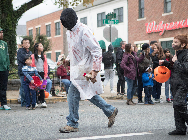 Parade goers enjoy the Newark Halloween Parade Sunday afternoon on Main Street in Newark.