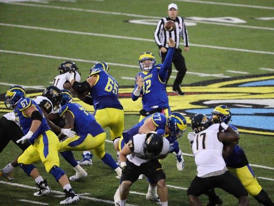 Delaware quarterback Pat Kehoe connects with Joe Walker for a touchdown in the third quarter of the Blue Hens' 40-36 win at Delaware Stadium Saturday.