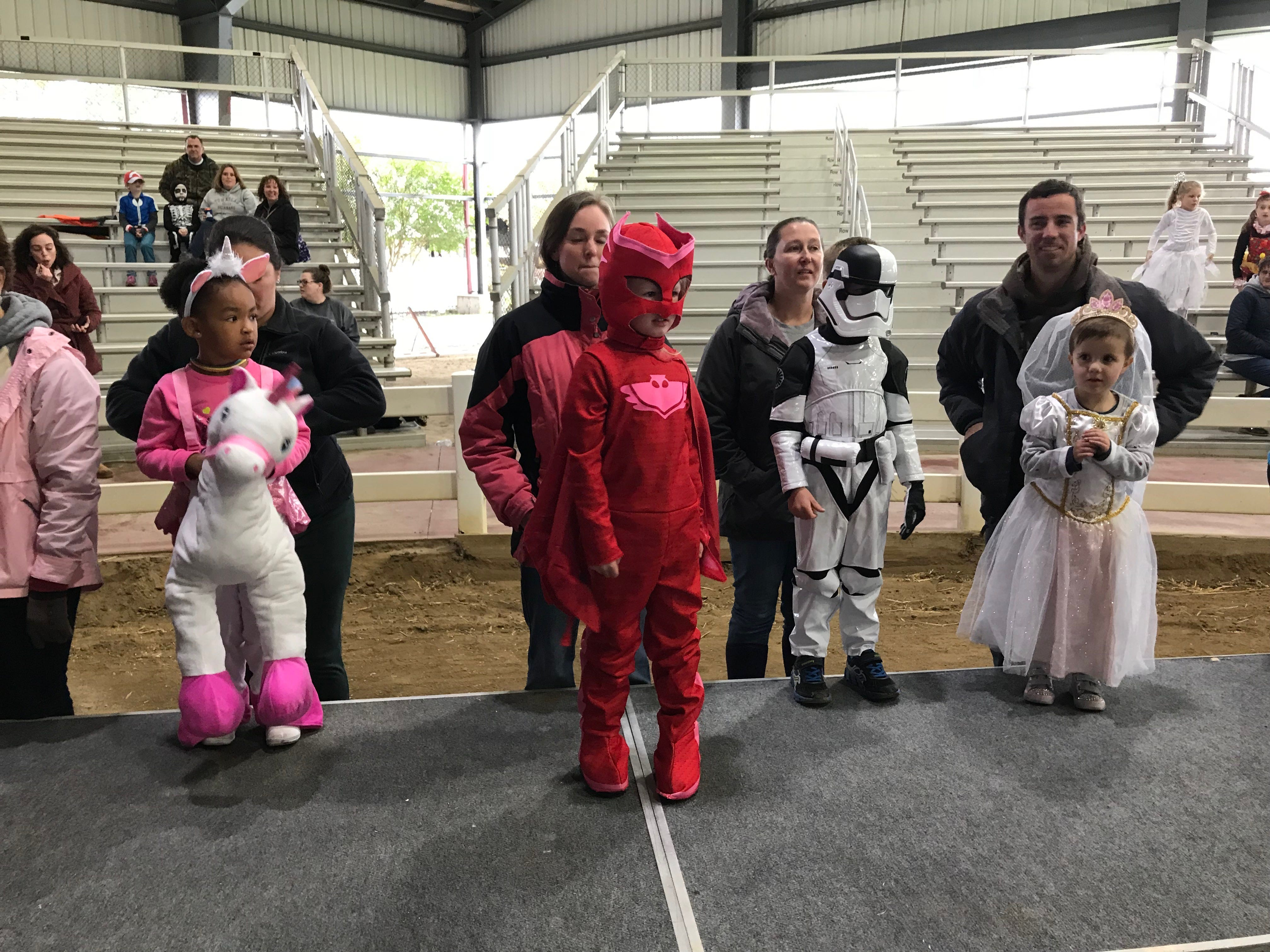 The younger kids start to line up for the costume contest at the first Great Delaware Pumpkin Carve Saturday.