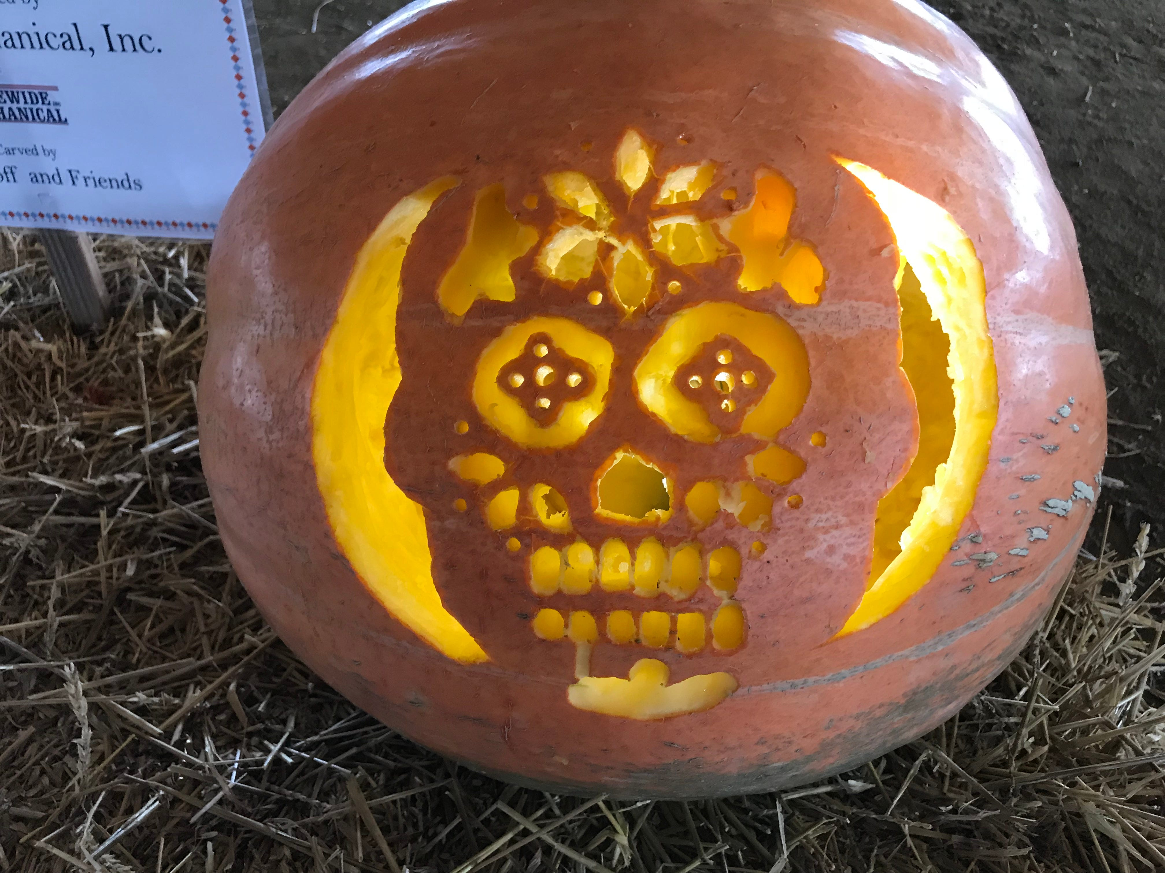 Cindy Westhoff and friends carved this sugar skull at the first Great Delaware Pumpkin Carve in Harrington.