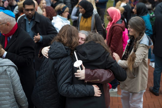 People gather for a community vigil honoring the Pittsburgh synagogue shooting victims Sunday on the North Green at the University of Delaware. Many regional religious and political leaders spoke at the event.