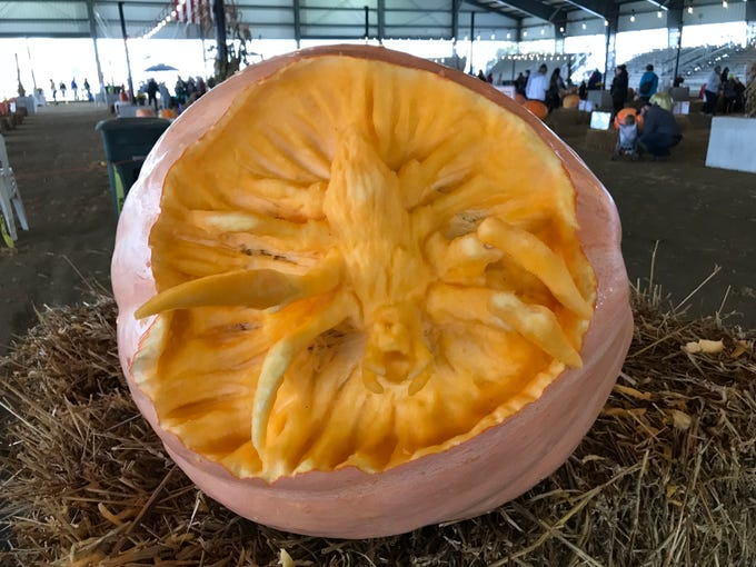 This pumpkin carved by The DE Stars offers a 3D spider reaching out of of the carving at the Great Delaware Pumpkin Carve Oct. 26-27 at the Delaware State Fair fairgrounds.
