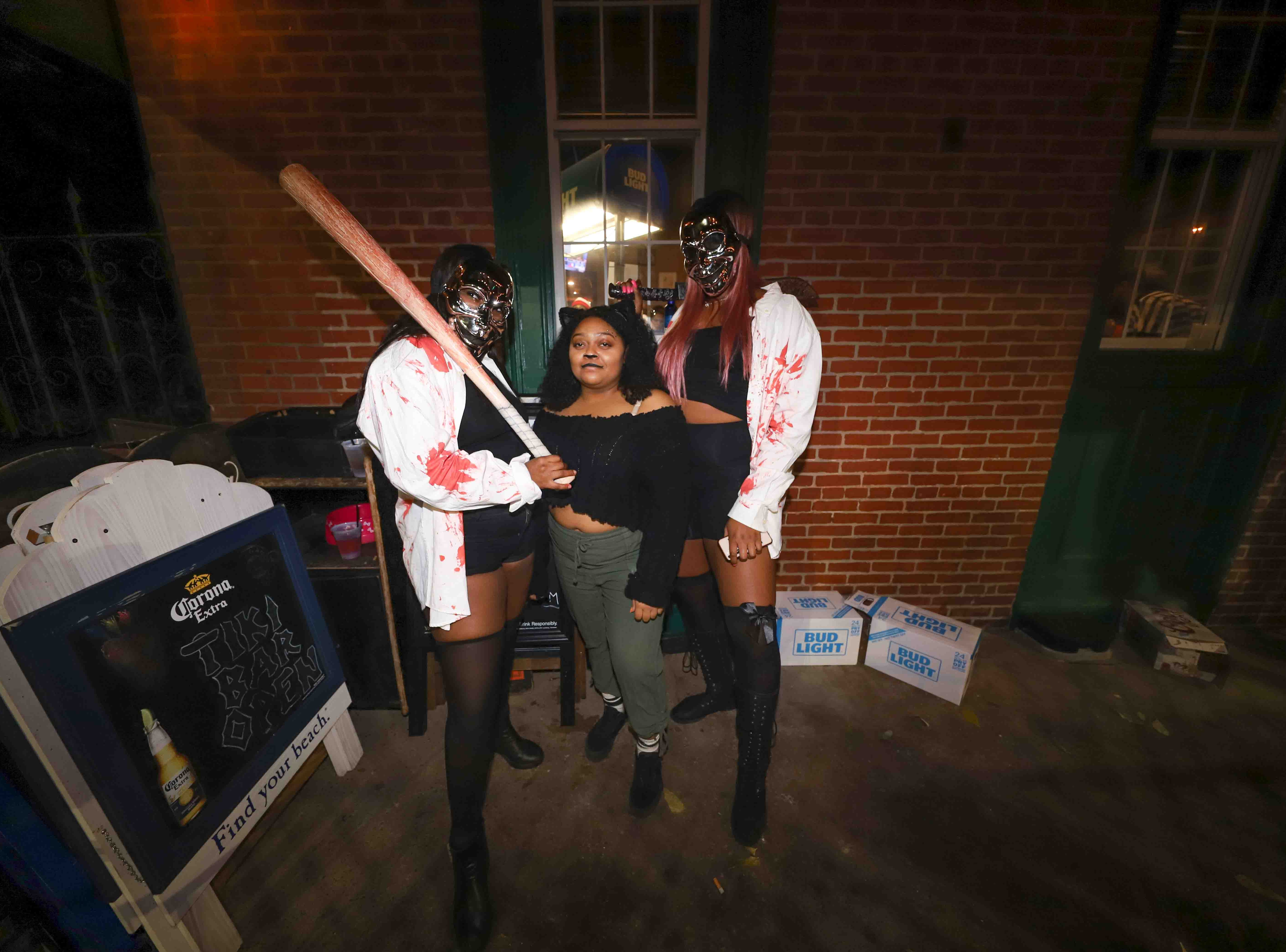 Patrons pose for a photo during the annual Trolley Square Halloween Loop Saturday, Oct. 27, 2018, at Kelly's Logan House in Wilmington.