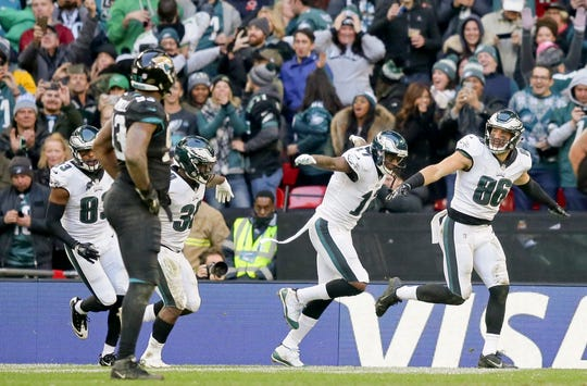 Philadelphia Eagles tight end Zach Ertz (86), right, celebrates after scoring a touchdown during the second half of an NFL football game against Jacksonville Jaguars at Wembley stadium in London, Sunday, Oct. 28, 2018. (AP Photo/Tim Ireland)