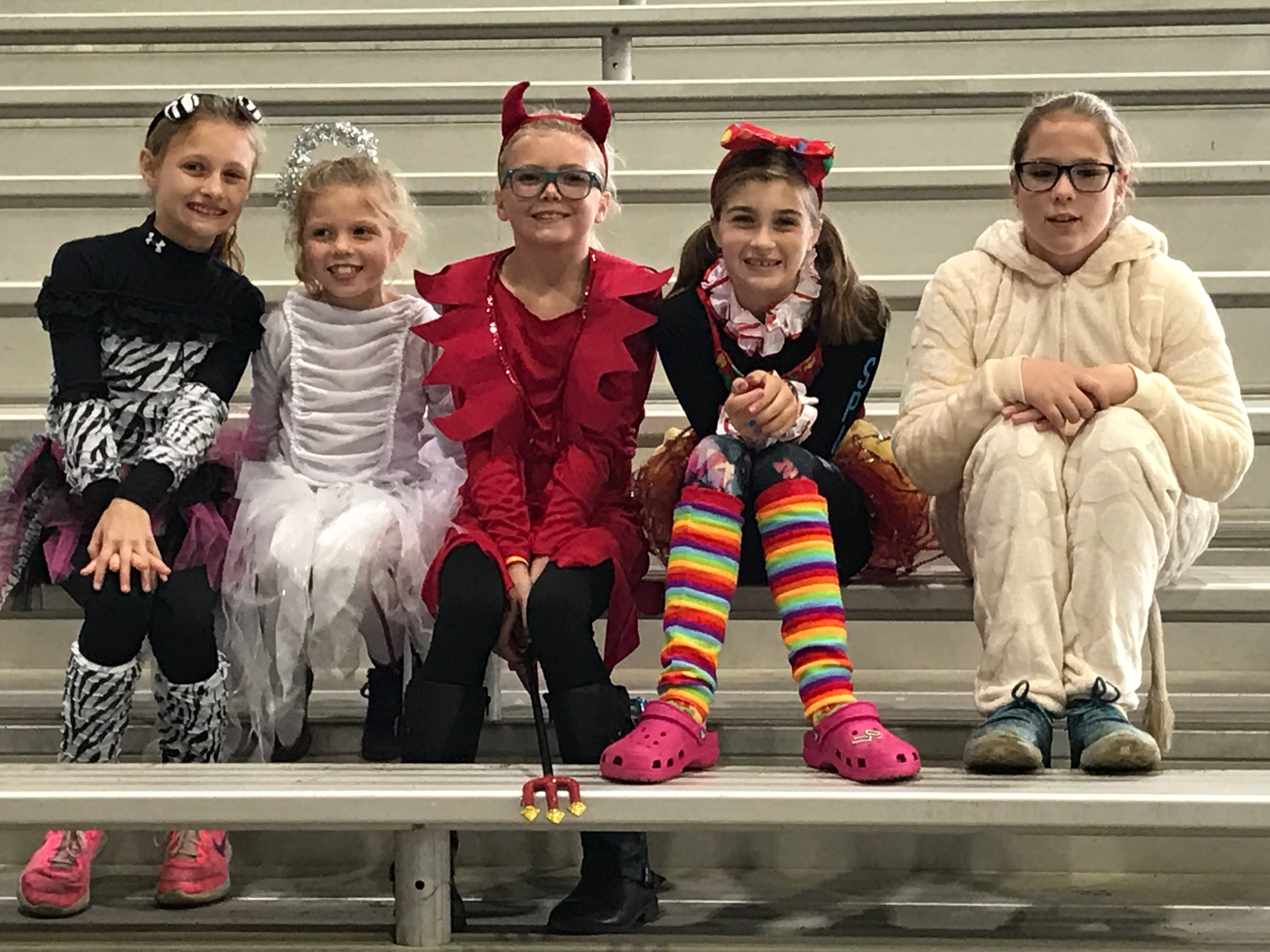 Older kids wait for their chance to compete in the costume contest Saturday afternoon at the first Great Delaware Pumpkin Carve in Harrington.