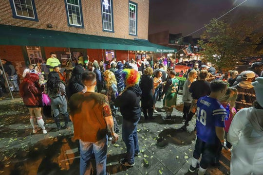Revelers on the front patio of Kelly's Logan House during the 39th annual Halloween Loop on Saturday in Wilmington. The same patio was the scene of a brawl at closing time, during which a New Castle man is accused of firing multiple gunshots.