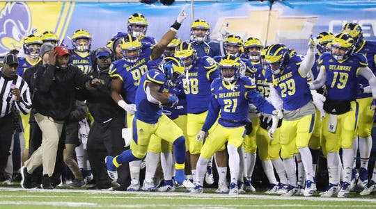 Delaware's Ray Jones (7) dances along the Blue Hen sideline as he stays in bounds on an interception that set up a touchdown in the fourth quarter of the Blue Hens' 40-36 win against Towson at Delaware Stadium Saturday.