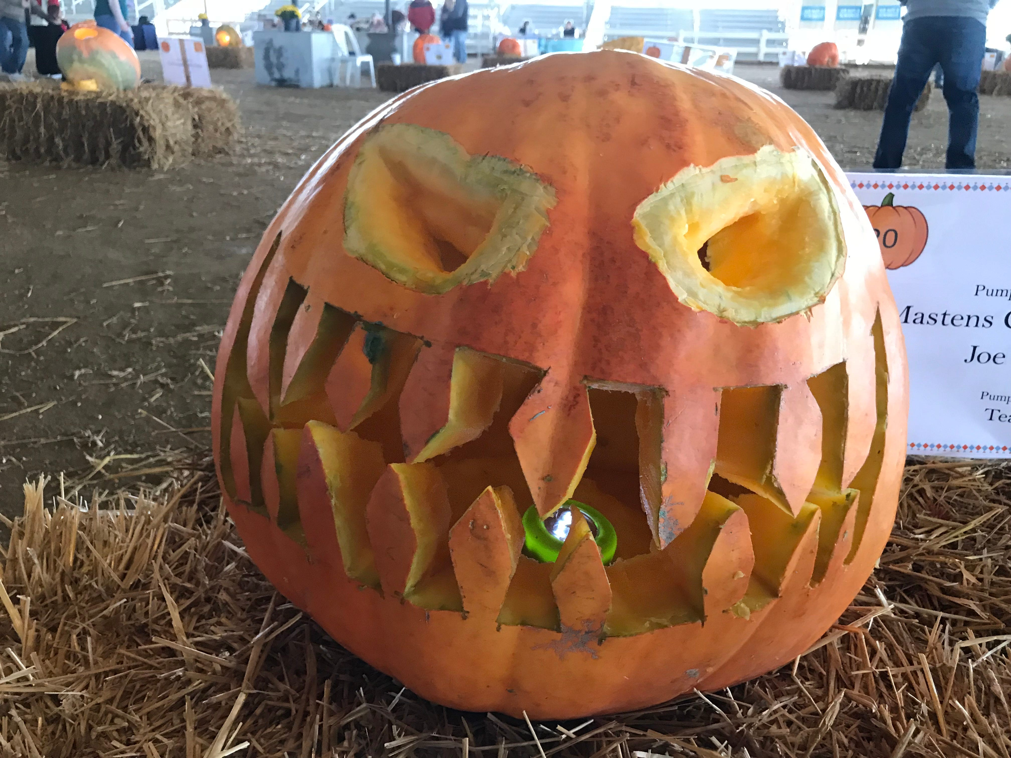 Somewhere, a pumpkin orthodontist is already eyething this pumpkin by Team Rust at the first Great Delaware Pumpkin Carve.