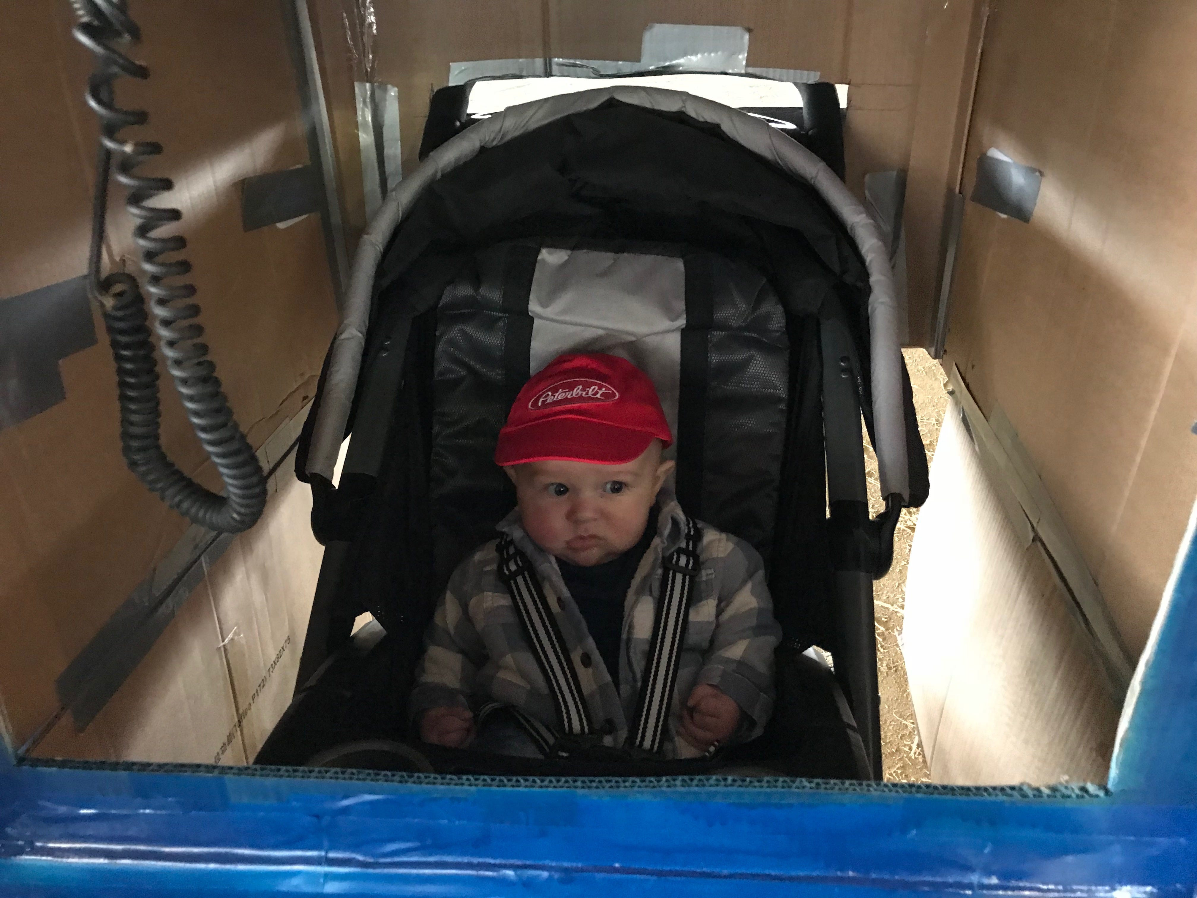 This trucker's just not sure about this whole stroller turned into Peterbilt truck thing at the first Great Delaware Pumpkin Carve.