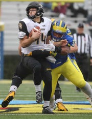 Delaware's Cam Kitchen hits Towson quarterback Tom Flacco in the first quarter at Delaware Stadium Saturday, Oct. 27, 2018.