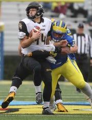Delaware's Cam Kitchen hits Towson quarterback Tom Flacco in the first quarter at Delaware Stadium Saturday.