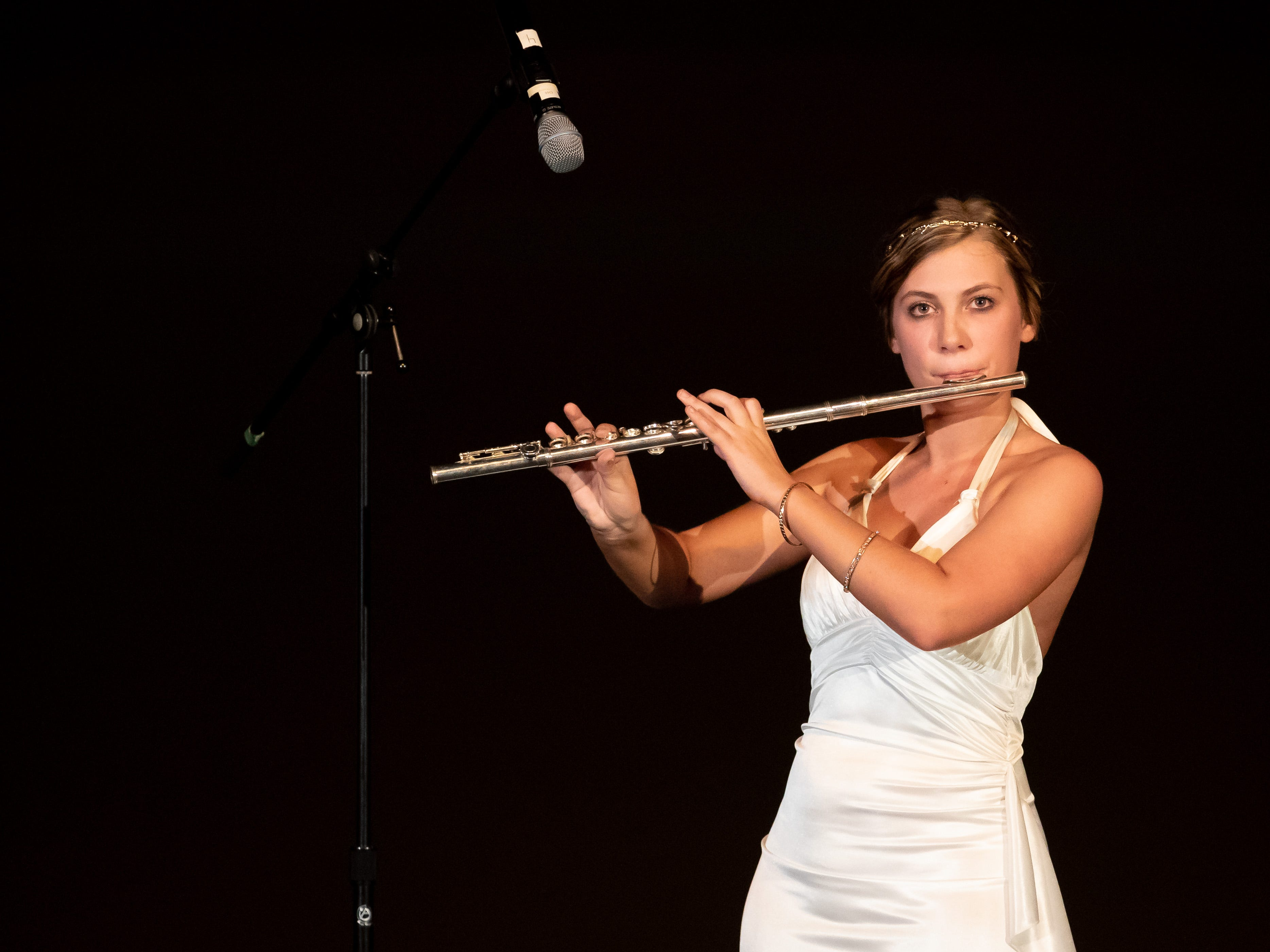 "Jennifer Krakow performs ""Go the Distance"" on flute in the Talent competition during the 2019 Miss Wisconsin Rapids Area Scholarship Pageant on Saturday, Oct. 27, 2018, at the Performing Arts Center of Wisconsin Rapids."