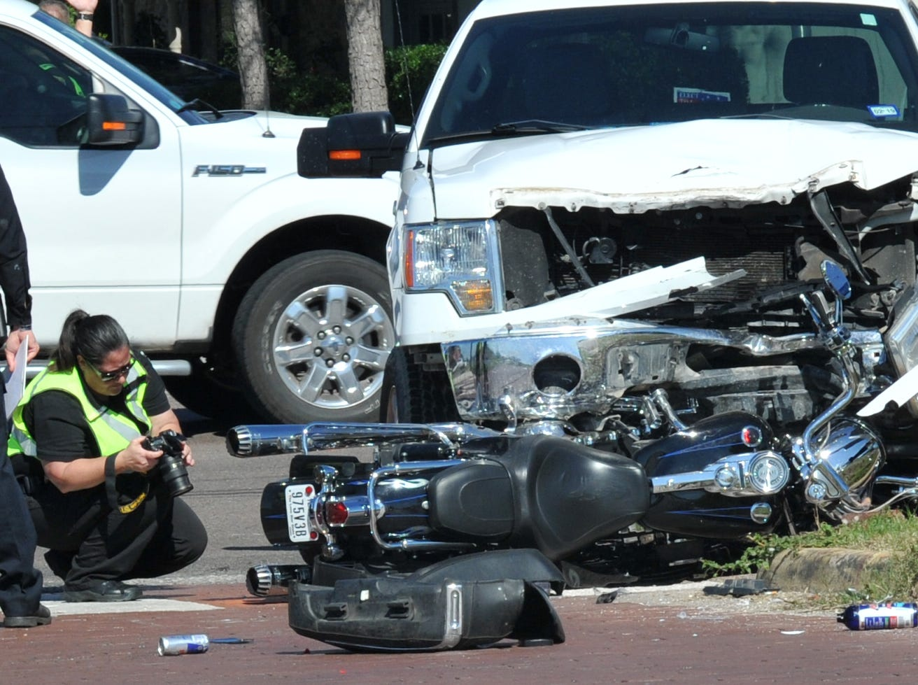 Wichita Falls police work the scene of a injury accident involving a motorcycle and pickup truck Sunday morning, shortly after 11, near the Southwest Parkway and McNeil Avenue intersection.