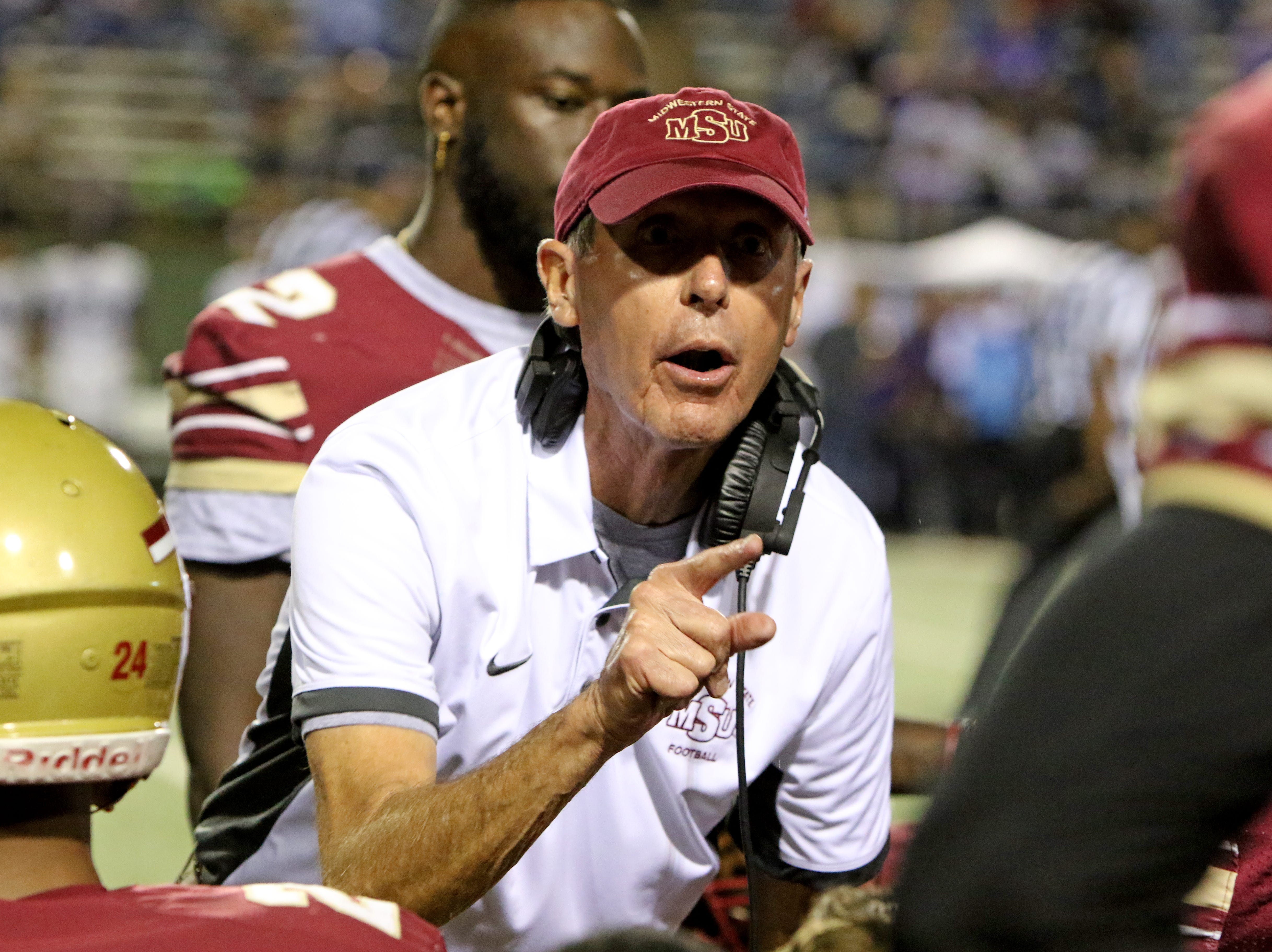 Midwestern State head football coach Bill Maskill talks to his players before the start of the fourth quarter in the game against Tarleton Saturday, Oct. 27, 2018, at Memorial Stadium. The Mustangs lost in overtime to the Texans 35-34 after a missed field goal.
