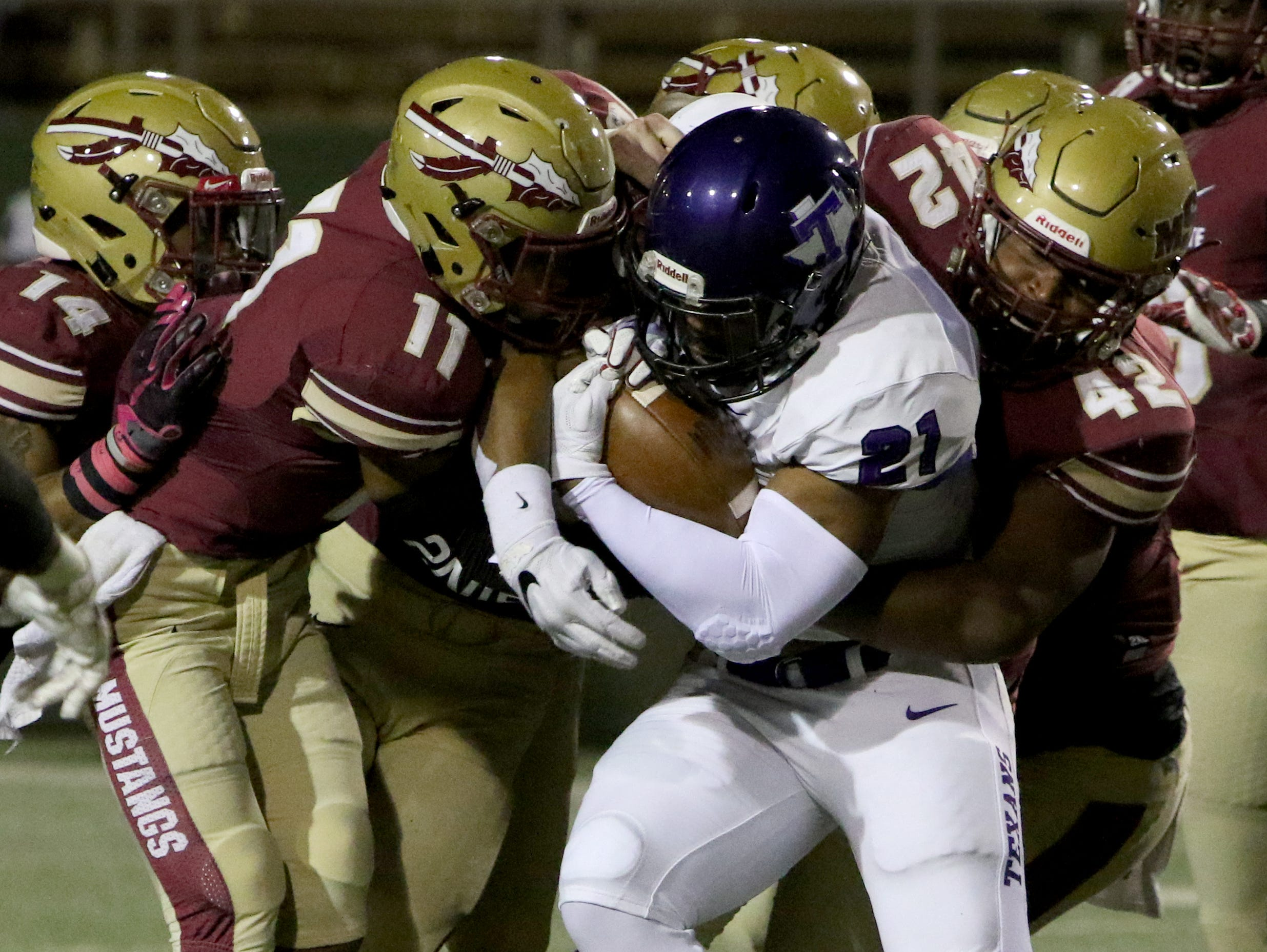 Tarleton's Zavier Turner is tackled by several Midwestern State defenders Saturday, Oct. 27, 2018, at Memorial Stadium. The Mustangs lost in overtime to the Texans 35-34 after a missed field goal.