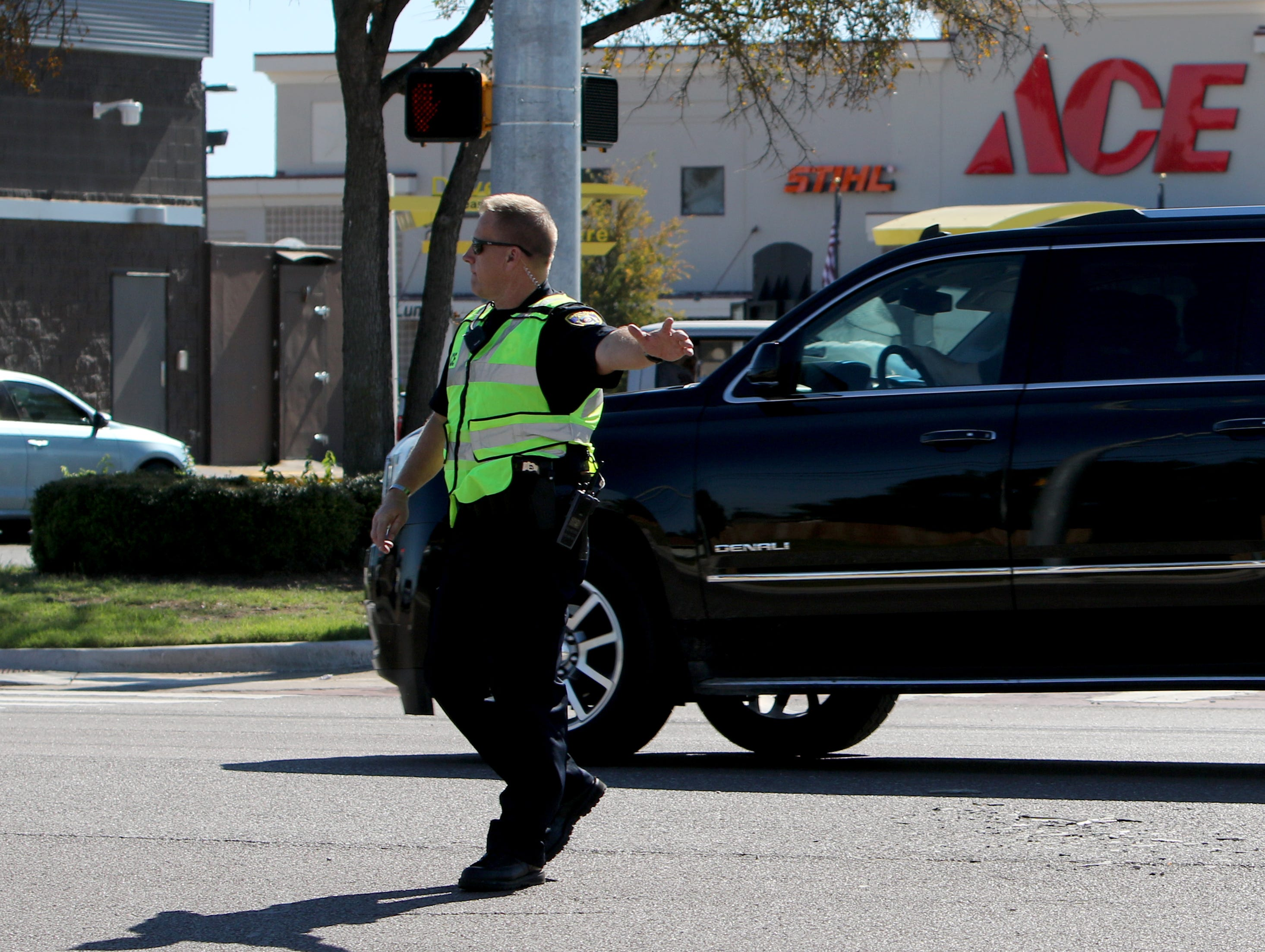 Police work to direct traffic at the site of a motorcycle wreak Sunday, Oct. 28, 2018, at the intersection of Southwest Parkway and Bridge Creek.