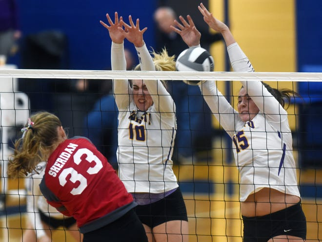 Unioto's Amanda McGlone, left, and Jocie Fisher go up for a block against Sheridan's Emma Conrad during the Shermans' 11-25, 14-25, 25-19, 22-25 loss in a Division II district final on Saturday at Southeastern.
