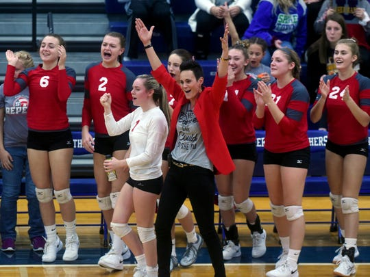 Sheridan coach Mandy Fox, middle, celebrates with her players after the Generals earned a win in the first game of a 25-11, 25-14, 19-25, 25-22 win against Unioto on Saturday at Southeastern.