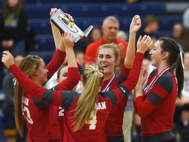 Sheridan players celebrate with the district championship trophy following a 25-11, 25-14, 19-25, 25-22 win against Chillicothe Unioto on Saturday at Southeastern High School.