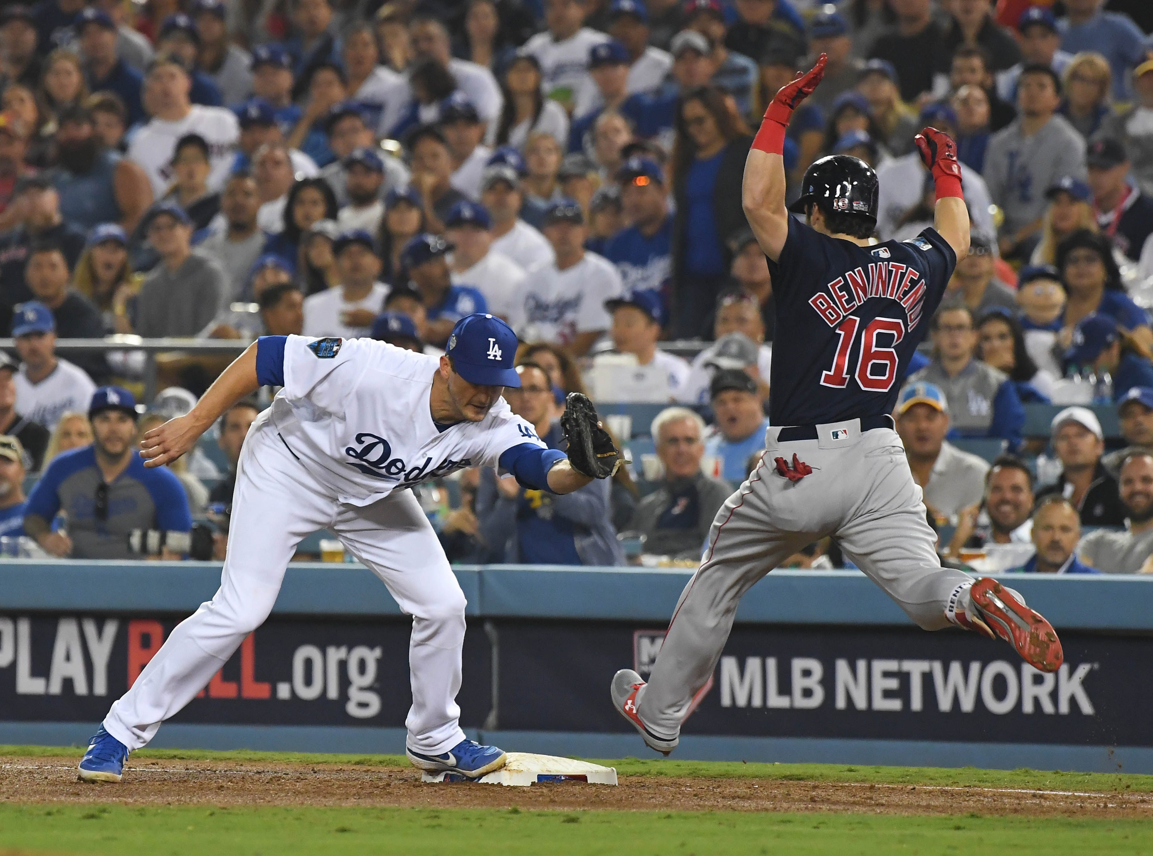Game 4 at Dodger Stadium: Andrew Benintendi is out at first base in the sixth inning.