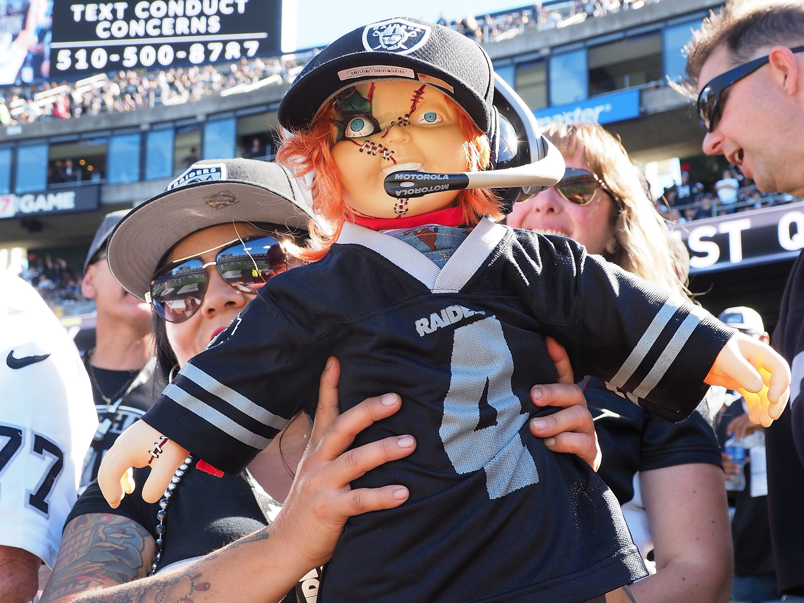 An Oakland Raiders fan holds a Chuckie doll before the game against the Indianapolis Colts at Oakland Coliseum.