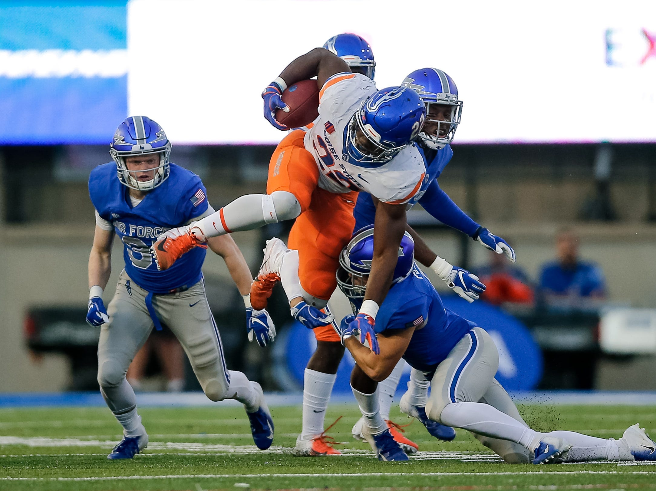 Boise State Broncos running back Alexander Mattison (22) is tackled by Air Force Falcons defensive back Jeremy Fejedelem (2) in the second quarter at Falcon Stadium.