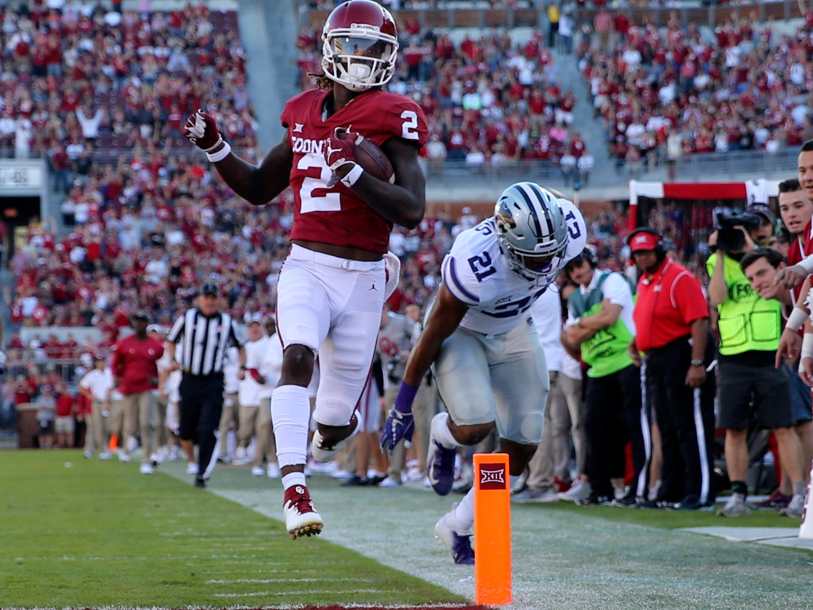 Oklahoma Sooners wide receiver CeeDee Lamb (2) runs for a touchdown past Kansas State Wildcats defensive back Kevion McGee (14) during the second half at Gaylord Family - Oklahoma Memorial Stadium.
