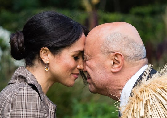 The Duchess of Sussex performs a hongi as she attends a traditional welcome ceremony on the lawns of Goverment House on Oct. 28, 2018, in Wellington, New Zealand.