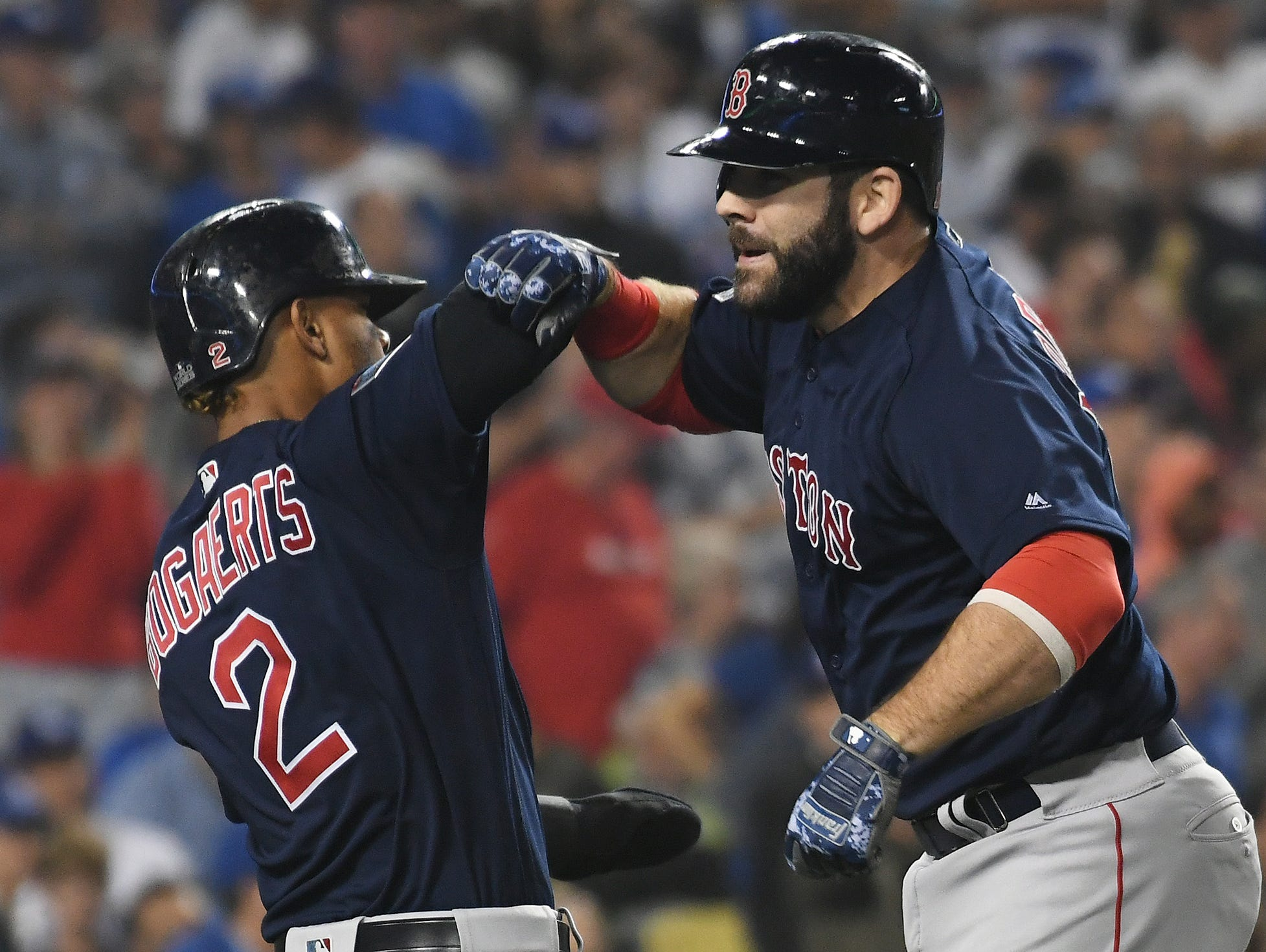 Mitch Moreland celebrates his three-run homer in the seventh with Xander Bogaerts.
