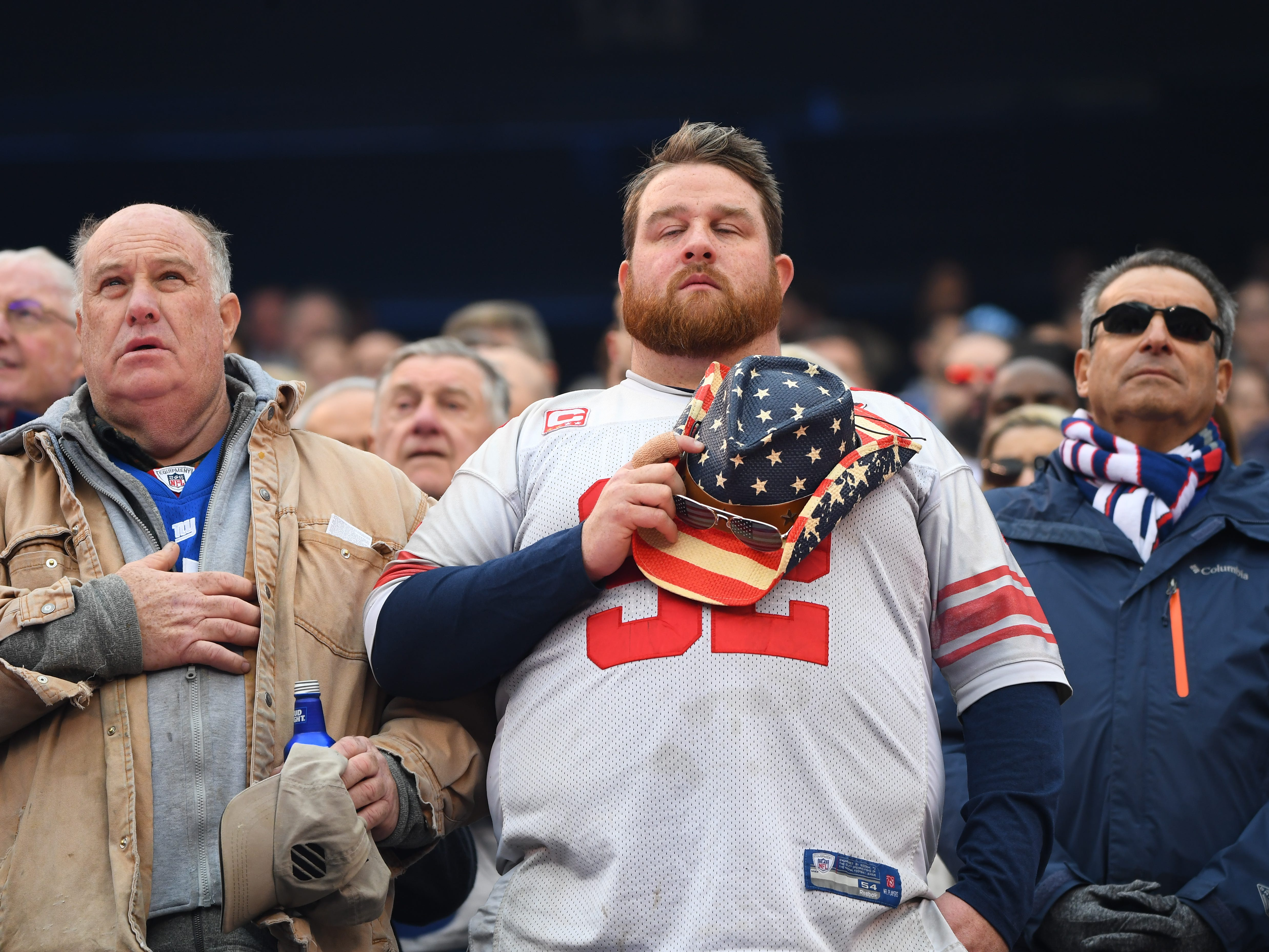 Fans pause for a moment of silence to honor the victims of the shooting in Pittsburgh before the game between the Washington Redskins and New York Giants, Sunday, Oct. 28, 2018, in East Rutherford, N.J.