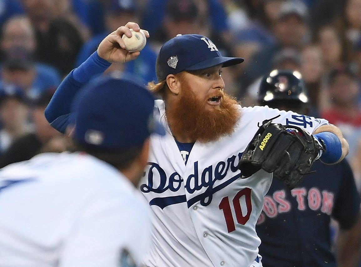 Game 4 at Dodger Stadium: Third baseman Justin Turner throws to second base for a force out in the third inning.