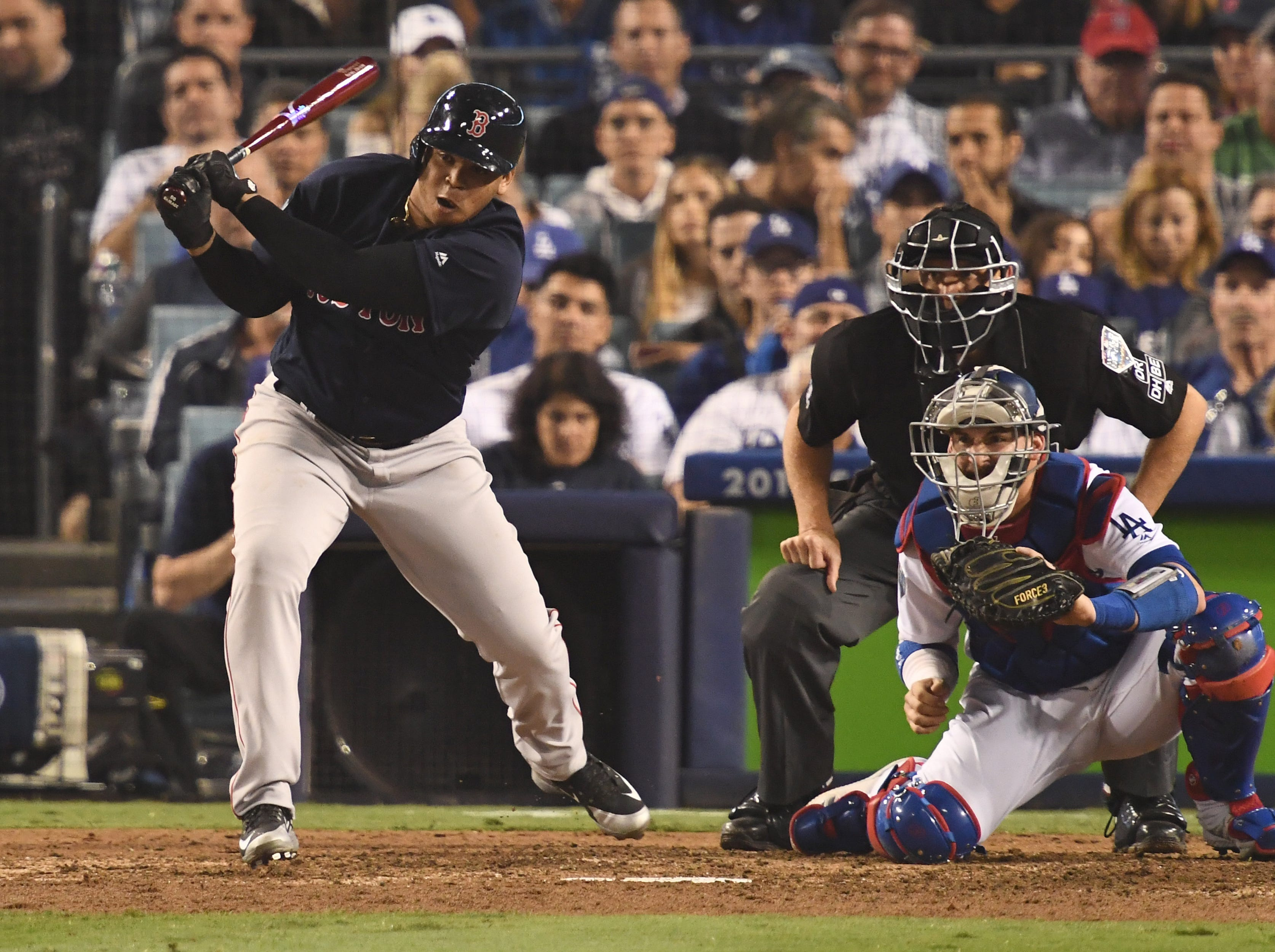 Game 4 at Dodger Stadium: Rafael Devers hits an RBI single in the ninth.