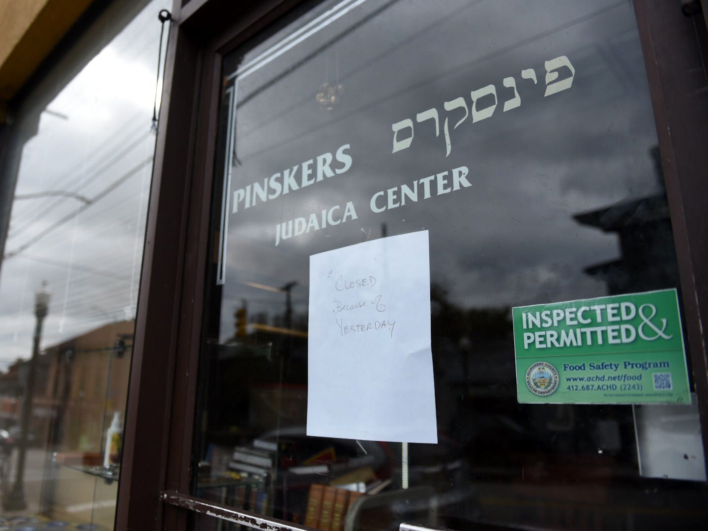 """Closed because of yesterday"" sign posted in the window on Pinskers Judaica Center on Murray Ave. in the Squirrel Hill neighborhood of Pittsburgh, Sunday, Oct. 28, 2018."