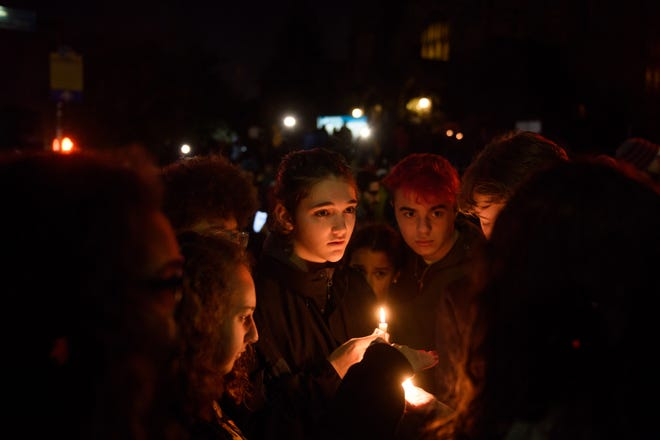 People gather for a interfaith candlelight vigil a few blocks away from the site of a mass shooting at the Tree of Life Synagogue on October 27, 2018 in Pittsburgh, Pennsylvania.