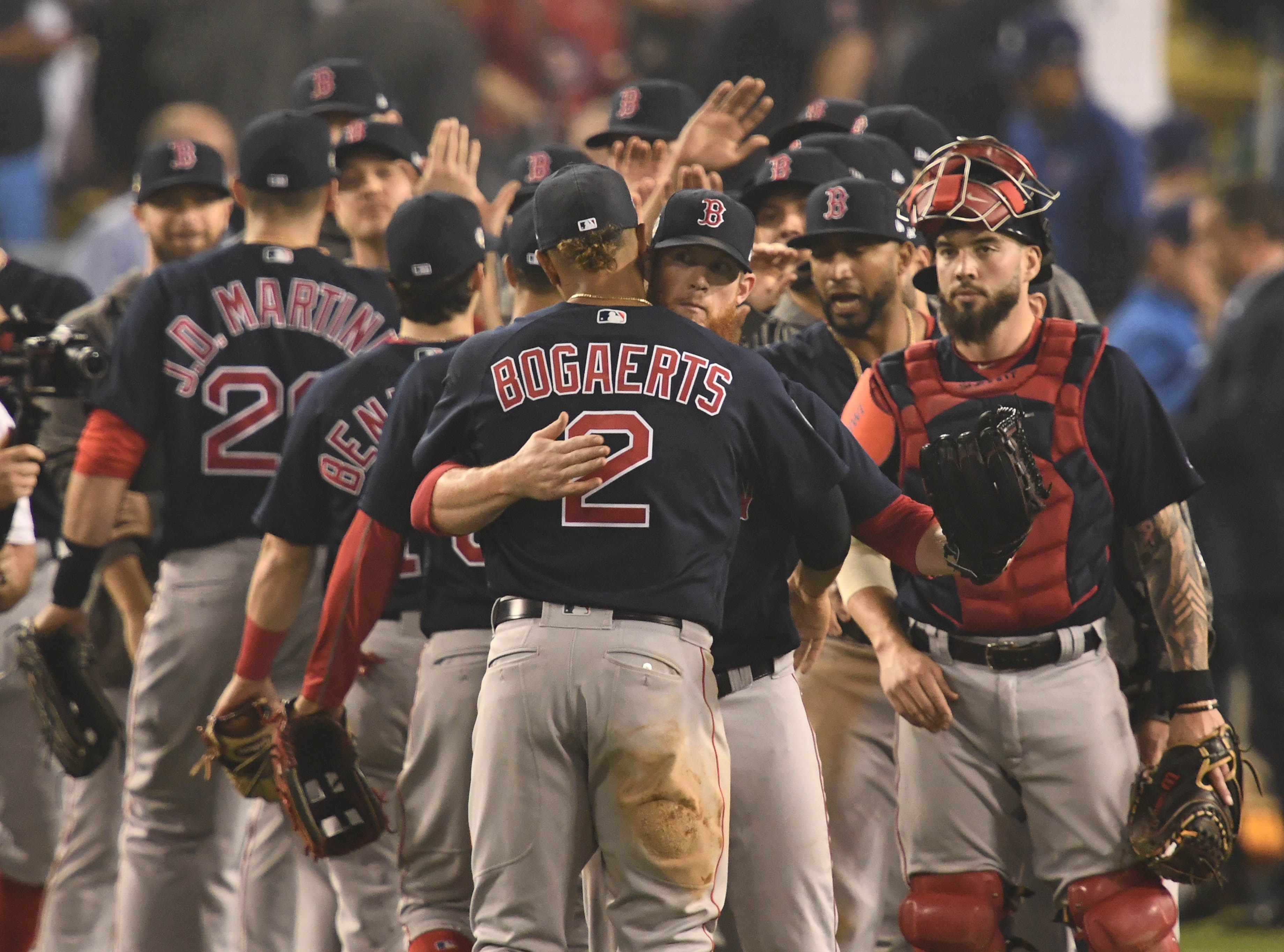 Game 4 at Dodger Stadium: Red Sox players celebrate after the win.