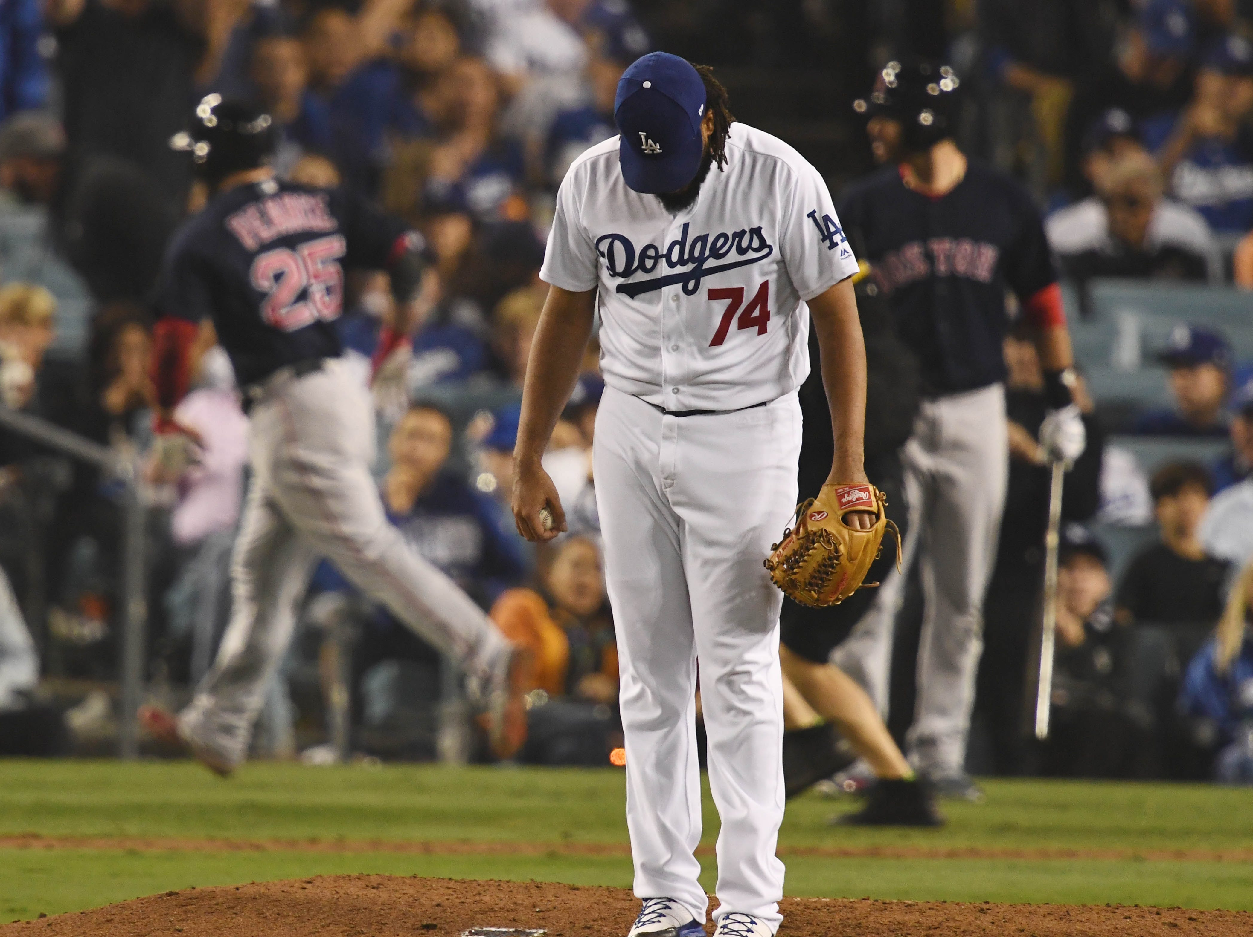 Game 4 at Dodger Stadium: Kenley Jansen reacts after giving up a game-tying homer in the eighth.