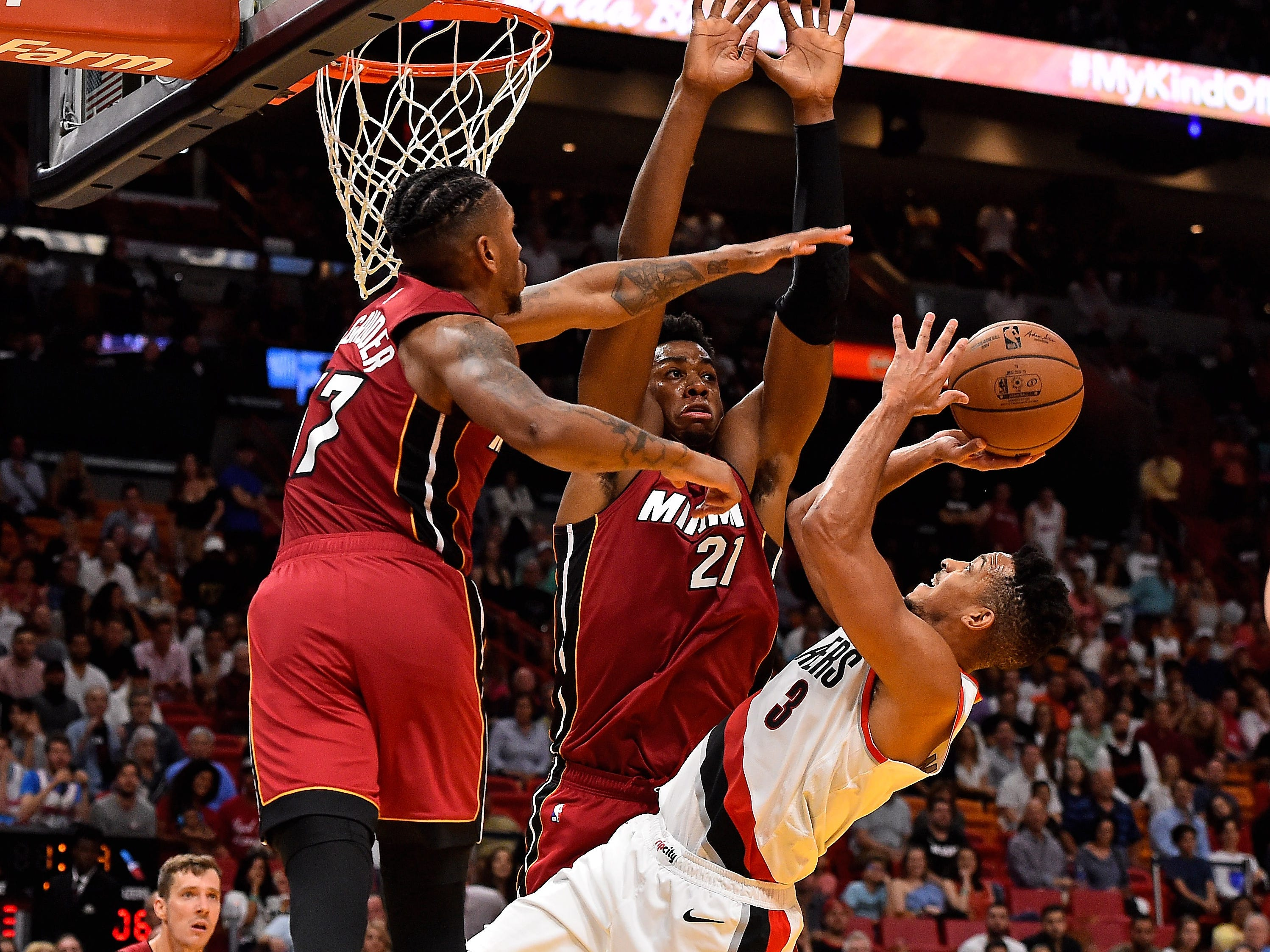 Oct. 27: Trail Blazers guard C.J. McCollum (3) tries to shoot over the double-team of Heat defenders Rodney McGruder (17) and Hassan Whiteside (21) during the second half in Miami.