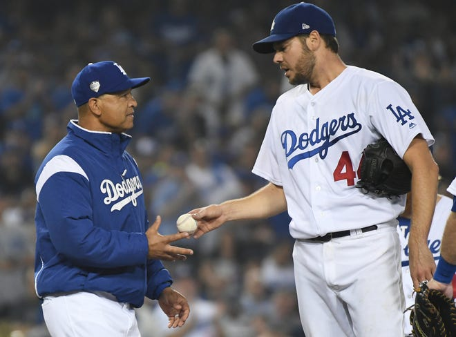Dave Roberts removes Rich Hill in the seventh inning of Game 4.